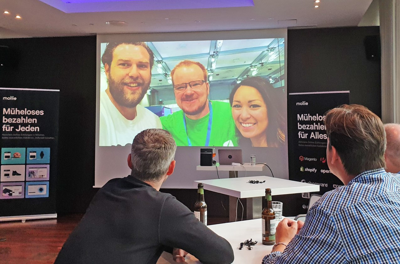 Picture of Morten Michelsen, Daniel Hüsken and Aleah Belluga at a talk at the Mollie Partner Day