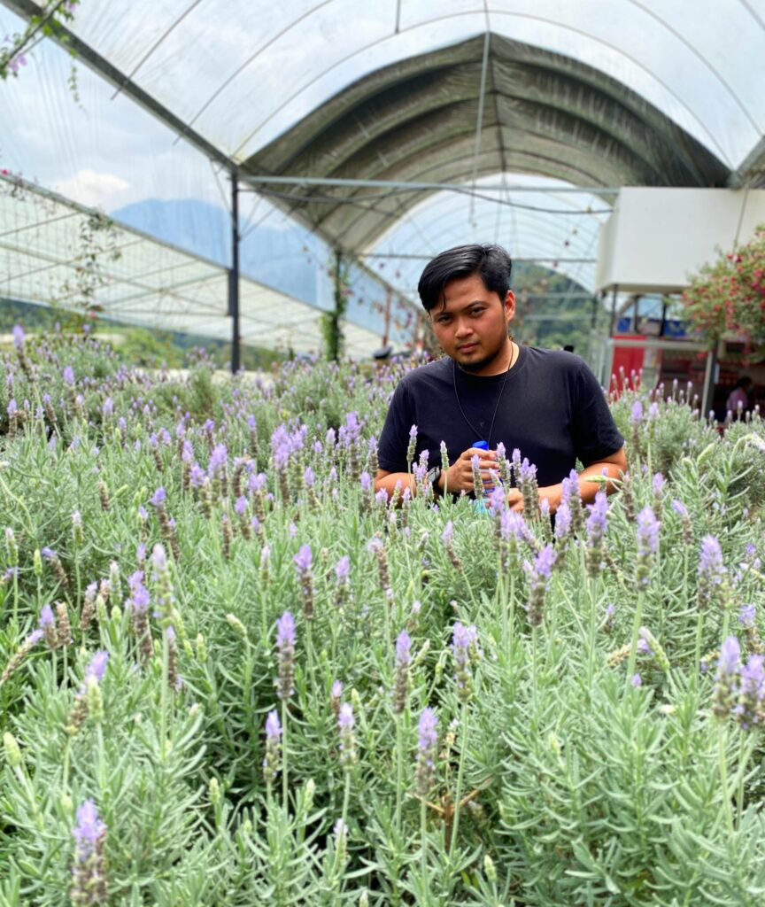 The picture shows Akmal in a field of lavender.
